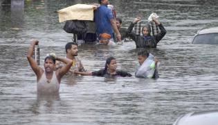 Rain wreaks havoc in Bihar alert in 13 districts Photo Gallery - Sakshi