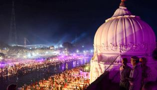 New Record As Nearly 6 Lakh Diyas Lit Up In Ayodhya Photo Gallery - Sakshi