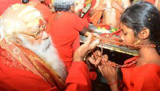 Bhavani Deeksha Maladharana begins in Vijayawada Photo Gallery - Sakshi