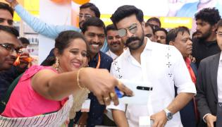 Ram Charan Launches Happi Mobiles At Vijayawada Photo Gallery - Sakshi