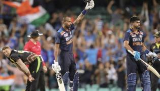 India beat Australia by 6 wickets in 2nd T20 to take series Photo Gallery - Sakshi