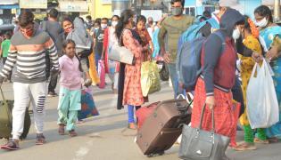 Huge Rush At Bus Stands Due To Sankranti Festival - Sakshi