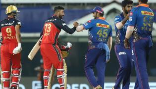 IPL 2021 Mumbai Indians vs Royal Challengers Bangalore Photo Gallery - Sakshi