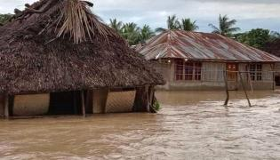 Heavy Rains Trigger Landslides, Floods In Indonesia Photo Gallery - Sakshi