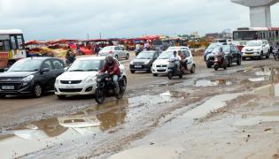 Heavy rains damage roads in Hyderabad - Sakshi