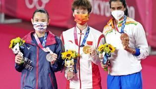 PV Sindhu Beats He Bing Jiao To Win Historic Bronze At Tokyo Olympics Photo Gallery - Sakshi