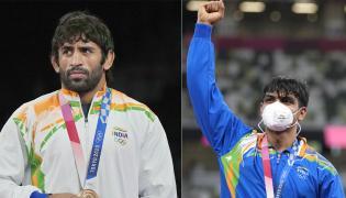 Neeraj Chopra wins gold and Bajrang Punia wins bronze Photo Gallery - Sakshi