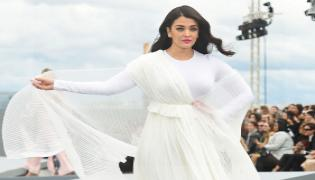 Photos : Aishwarya Rai Bachchan Stuns In White At Paris Fashion Week  - Sakshi