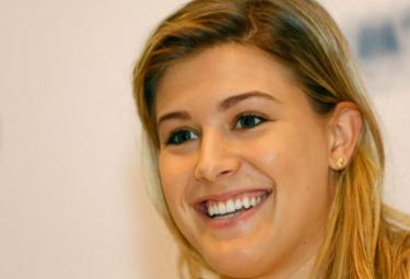 Eugenie Bouchard and U.S.T.A. Reach Settlement - Sakshi