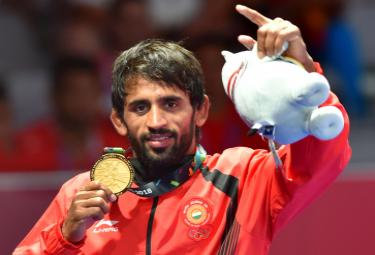 Indian Wrestler Bajrang Punia Wins Gold at Asian Games 2018 - Sakshi