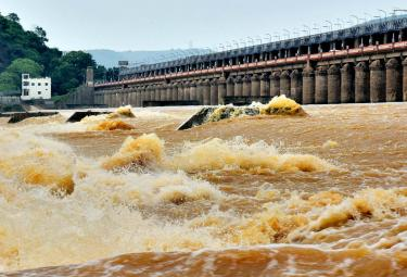 Record Level Flood Water Reaches Prakasam Barrage Photo Gallery - Sakshi