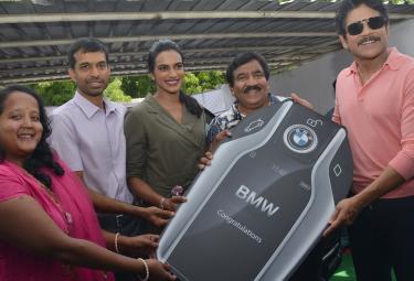 Nagarjuna Gifted BMW Car to PV Sindhu - Sakshi