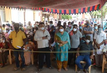 people Ttaking Corona Vaccine And Corona Test Photo Gallery - Sakshi
