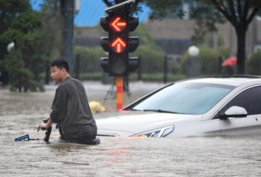 Heavy rainfall floods streets and subway stations in China Photo Gallery - Sakshi
