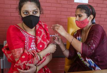 Covid19 Vaccination WorldWide - Sakshi