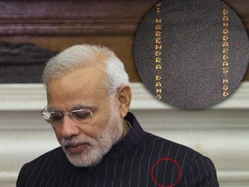 మోదీ సూటుకు అక్షరాలా 'కోటి' - Sakshi