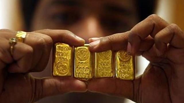 gold biscuits in side body - Sakshi
