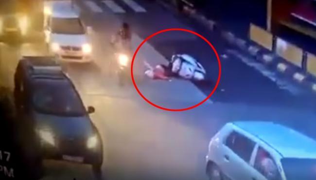 Mumbai Woman crushed by crane after she loses scooter balance - Sakshi