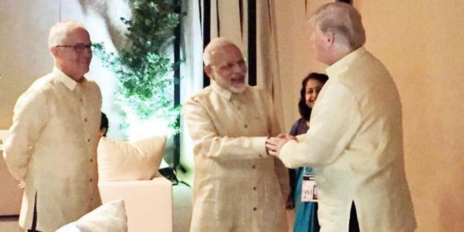 PM Modi briefly meets Donald Trump, world leaders at ASEAN gala dinner - Sakshi