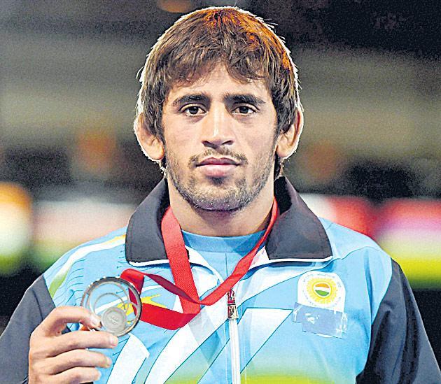 Bajrang, Vinod assured of silver at U-23 World Wrestling  - Sakshi