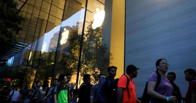 Why do people queue up for hours at Apple stores - Sakshi