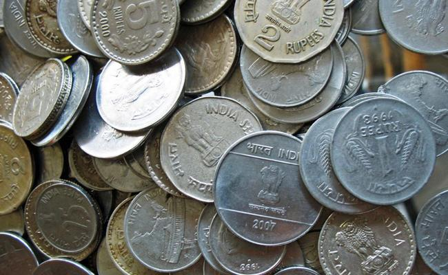 Government resumes coin production, but mints to work at slow pace - Sakshi