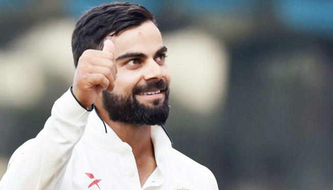 Kohli second Indian to reach 900-point mark in ICC rankings - Sakshi