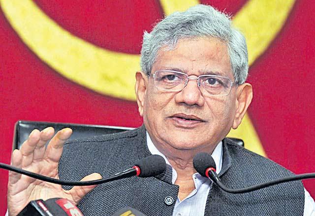 CPM decides against alliance with Congress as Prakash Karat wins out over Sitaram Yechury - Sakshi