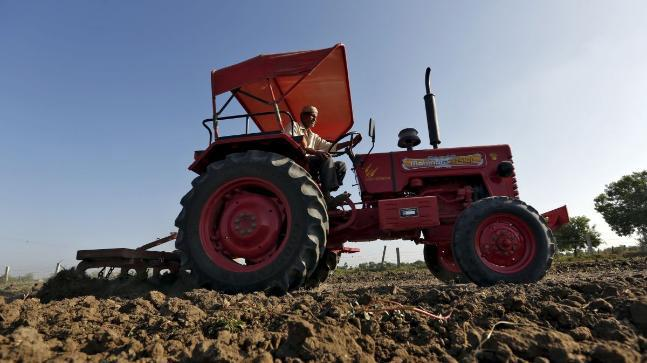 Loan recovery agents take away UP farmer tractor, crush him - Sakshi
