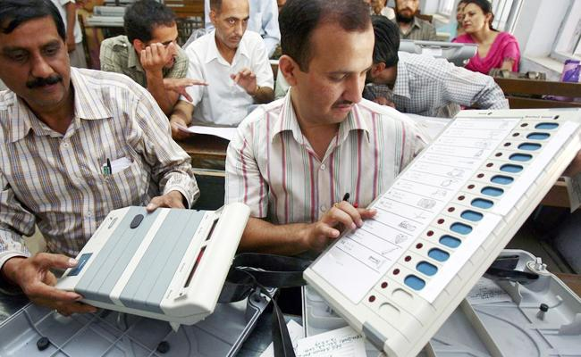 candidate photo will be seen in EVM  - Sakshi