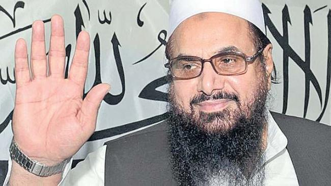 Hafiz Saeed slaps Rs 100 million 'defamation' notice on Pak defence minister - Sakshi