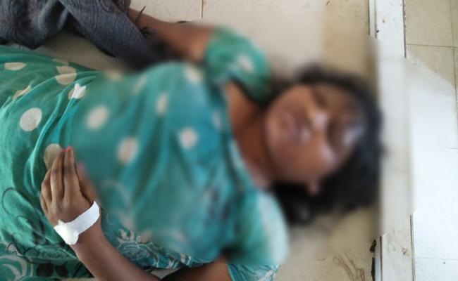 tribal young woman commit to suicide - Sakshi