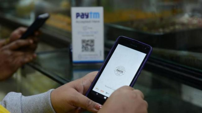 Paytm rolls back feature that turned wallet recharge via credit card into vouchers - Sakshi