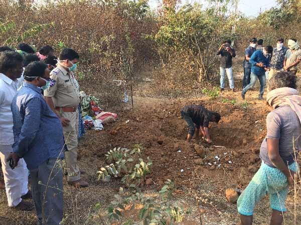 woman Dead Body Dug Out From Grave For Postmortem - Sakshi