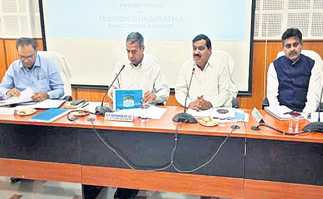 minister warns officers negligence in mission bhagiratha works - Sakshi
