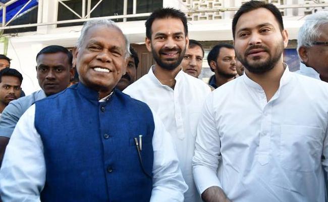 Jitan Ram Manjhi quits NDA to shake hand with RJD - Sakshi
