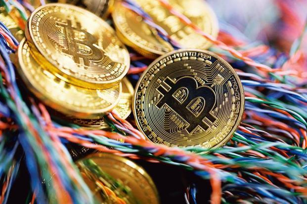 Govt to bar cryptocurrencies from its payments system - Sakshi