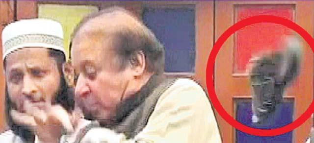 Shoe hurled at former Pakistan PM Nawaz Sharif - Sakshi