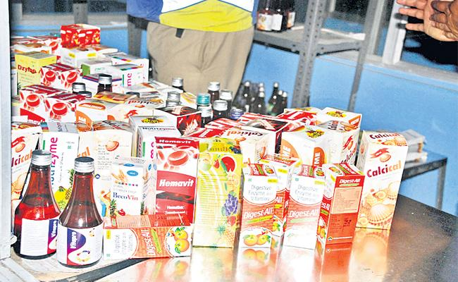 Police Attacks On Fake Nutrition food, syrups Manufacturing Centre - Sakshi
