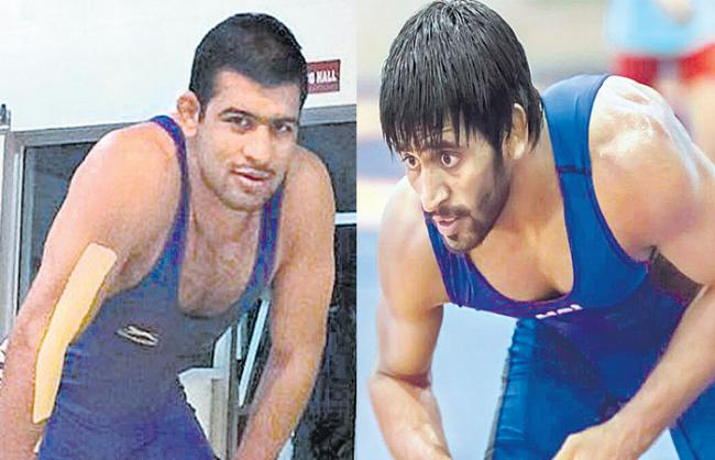 Bronze medals were achieved the Bajrang punia and vinod - Sakshi