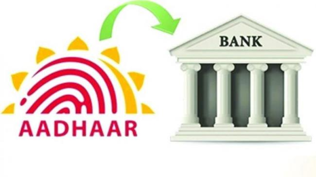 80% bank accounts, 60% mobile connections linked with Aadhaar - Sakshi
