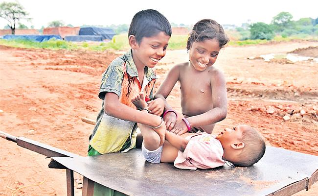 Brother And Sister Play With Kid - Sakshi