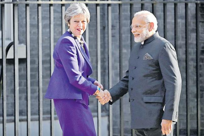 PM Modi Meets Theresa May For Bilateral Talks On Immigration, Counter-Terrorism - Sakshi