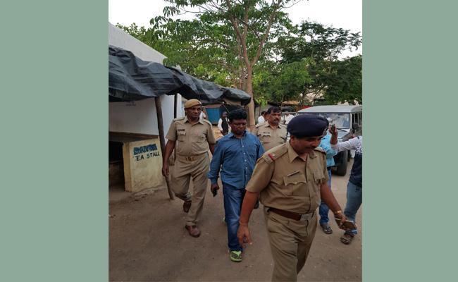 GRP SI Arrested In Berhampur - Sakshi