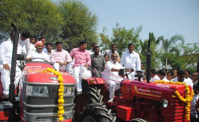 Telangana Speaker Madhusudhana Chary Distributed Subsidy Tractors At parakala - Sakshi