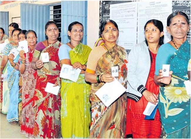 70% voter turnout, exit polls predict hung assembly - Sakshi