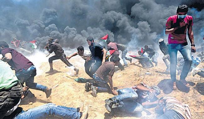 Israeli forces kill 55 in Gaza clashes as US opens Jerusalem embassy - Sakshi