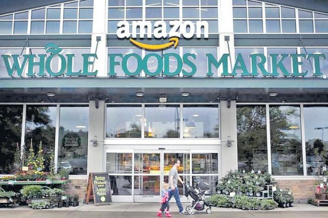 Amazon cuts Whole Foods prices for Prime members in new grocery - Sakshi
