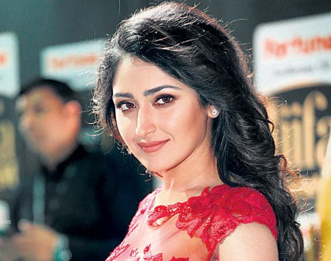 Sayesha Saigal Going to Romance with Surya and Karthi - Sakshi