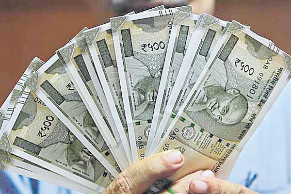 Rupee surges 56 paise vs dollar - Sakshi